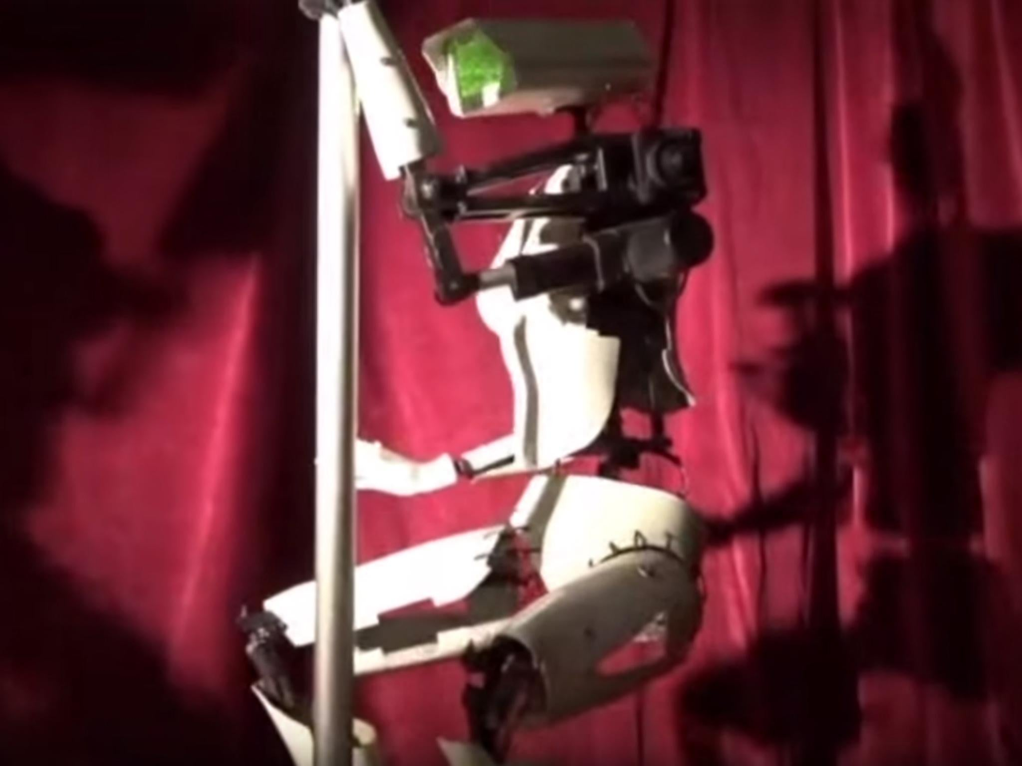 Robot pole-dancers with CCTV cameras for heads perform in Las Vegas club during CES 2018