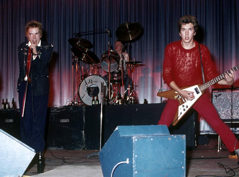 Pistol-packing: (from left) Johnny Rotten, Paul Cook and Steve Jones. Bassist Glen Matlock played on their only official album before being replaced by Sid Vicious
