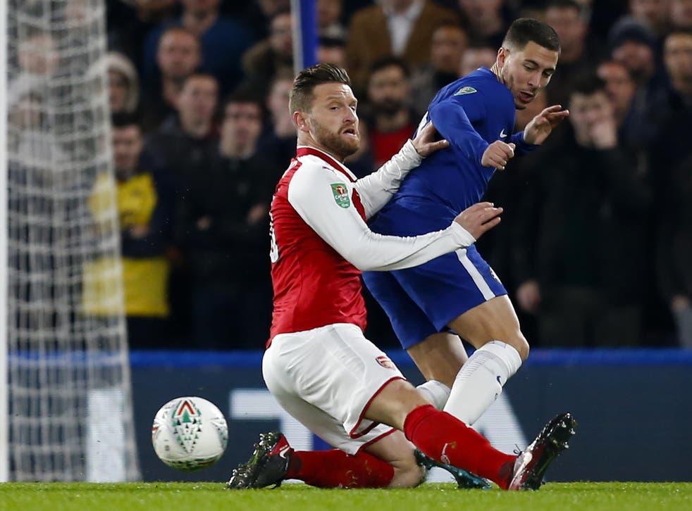 Eden Hazard is challenged by Shkodran Mustafi