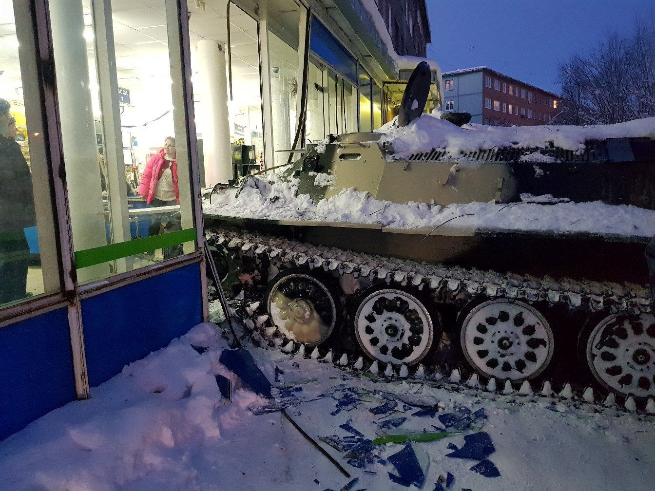 Russian man drives stolen tank into supermarket before running in to steal wine
