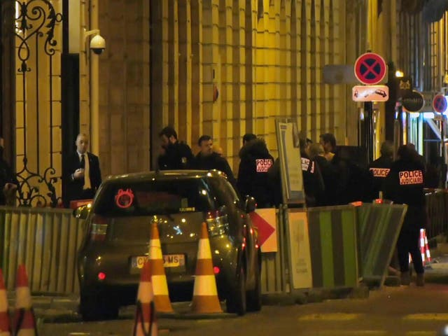 French police attend the scene outside the Ritz Hotel in Paris after a robbery on Wednesday evening