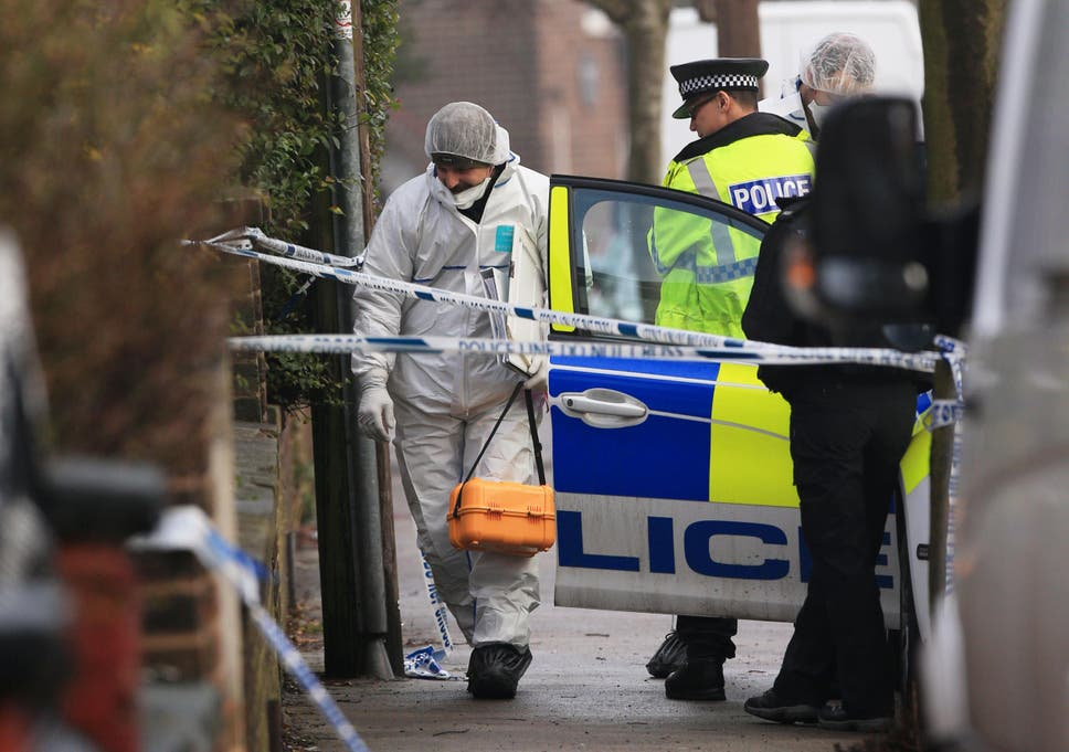 38c12b573a A forensics officer at the scene of a murder investigation in Matlock Road,  Stockport