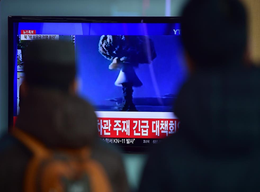 A news report on North Korea's first hydrogen bomb test at a railroad station in Seoul, 2016