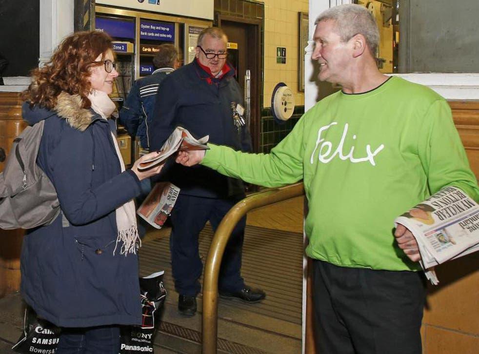 Evening Standard vendor John Coffey shows off his sweatshirt as a volunteer for the Felix Project