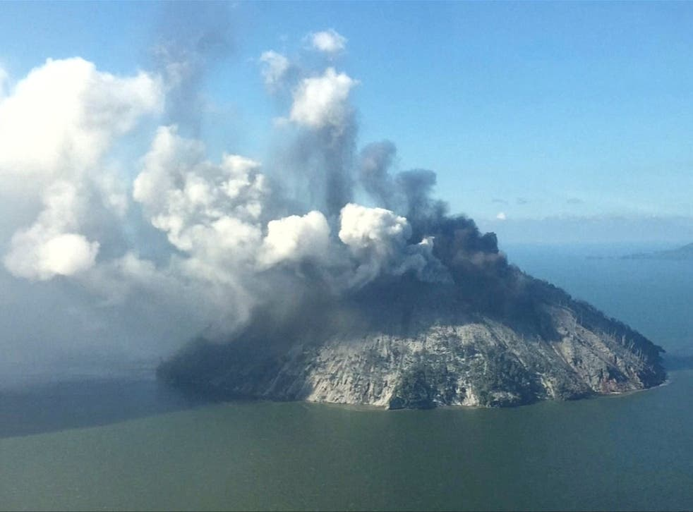 The remote island volcano of Kadovar spews ash into the sky in Papua New Guinea. Pictured on 6 January.