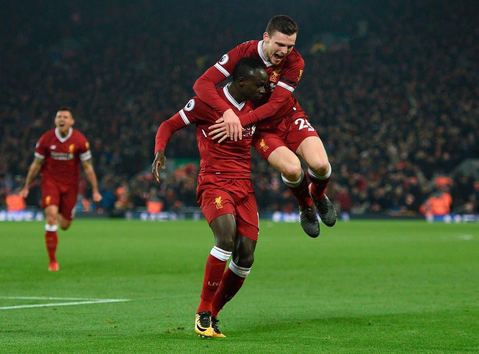 Sadio Mane celebrates with Andrew Robertson after scoring Liverpool's third goal