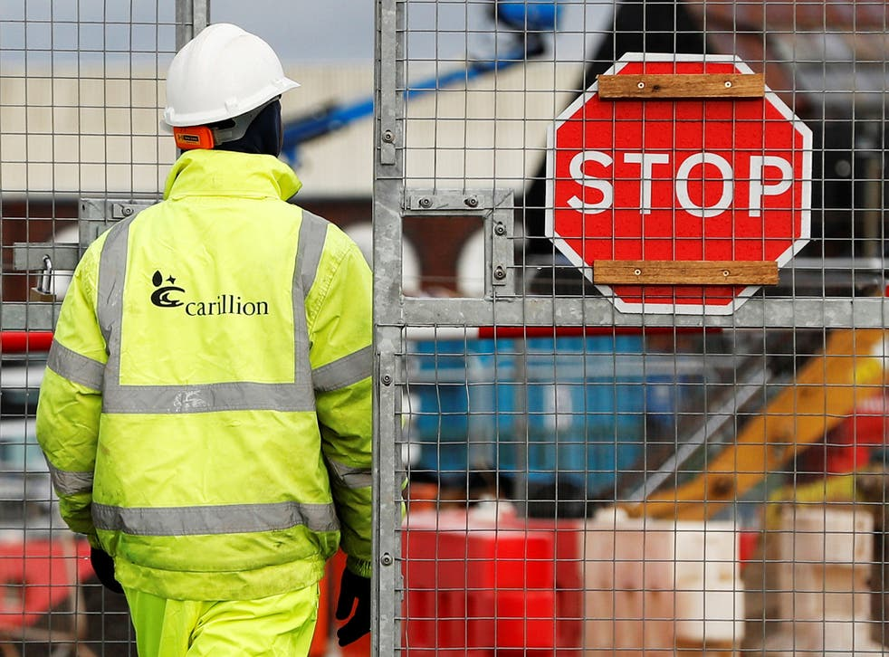 A worker walks into Carillion's Midland Metropolitan Hospital construction site