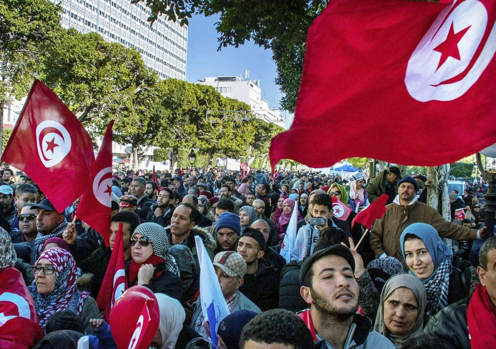 A rally in Tunis to mark seven years since the Jasmine Revolution – but  beneath the