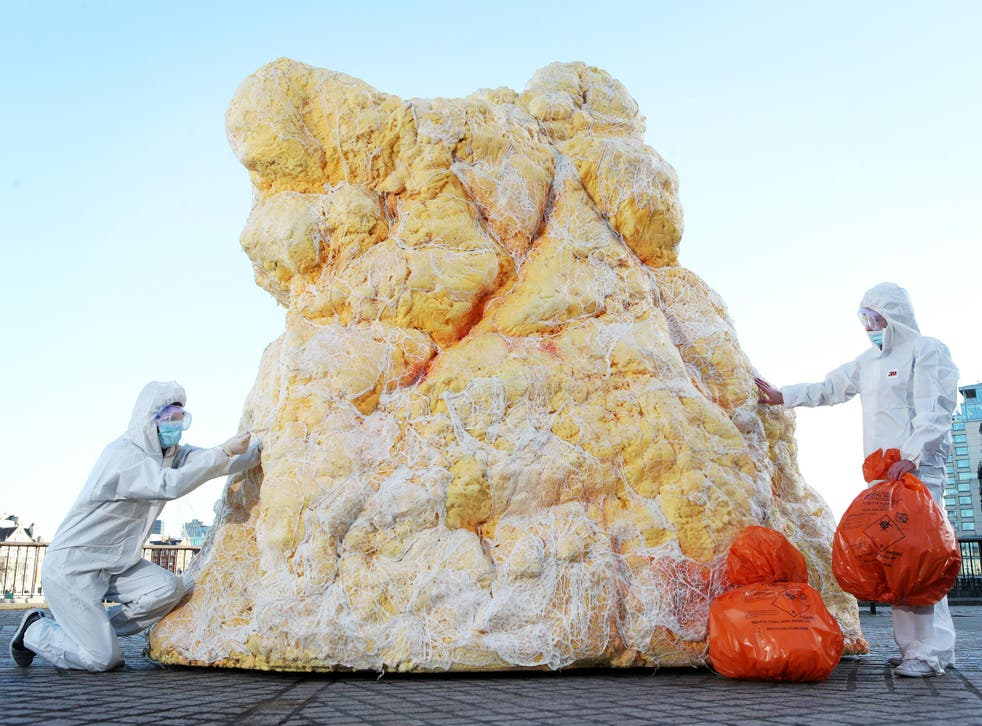 A gigantic lump of real fat measuring 12 feet high appears in London to shock Brits into assessing blood health