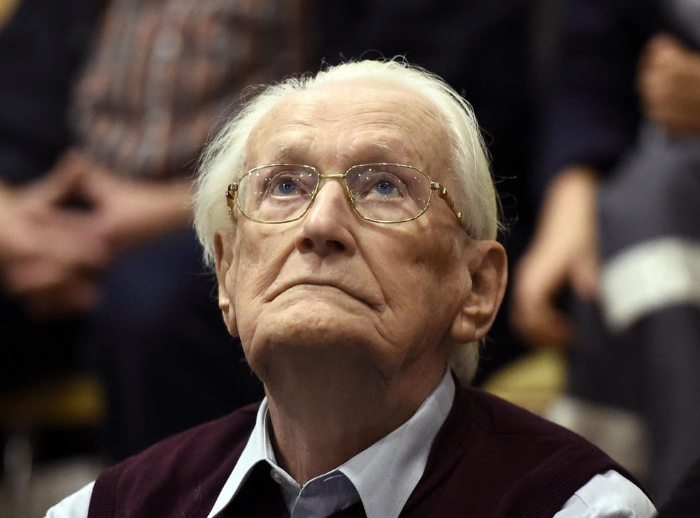 Former SS officer Oskar Groening listens to the verdict of his trial at court in Lueneburg, northern Germany, in 2015