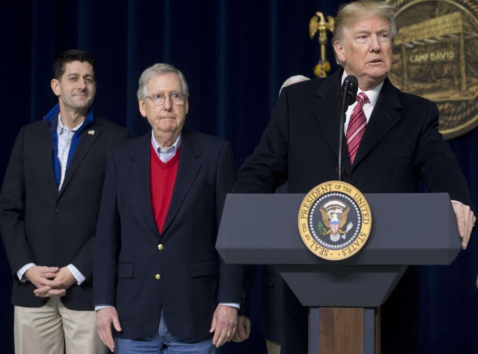 US President Donald Trump speaks alongside Speaker of the House Paul Ryan and Senate Majority Leader Mitch McConnell