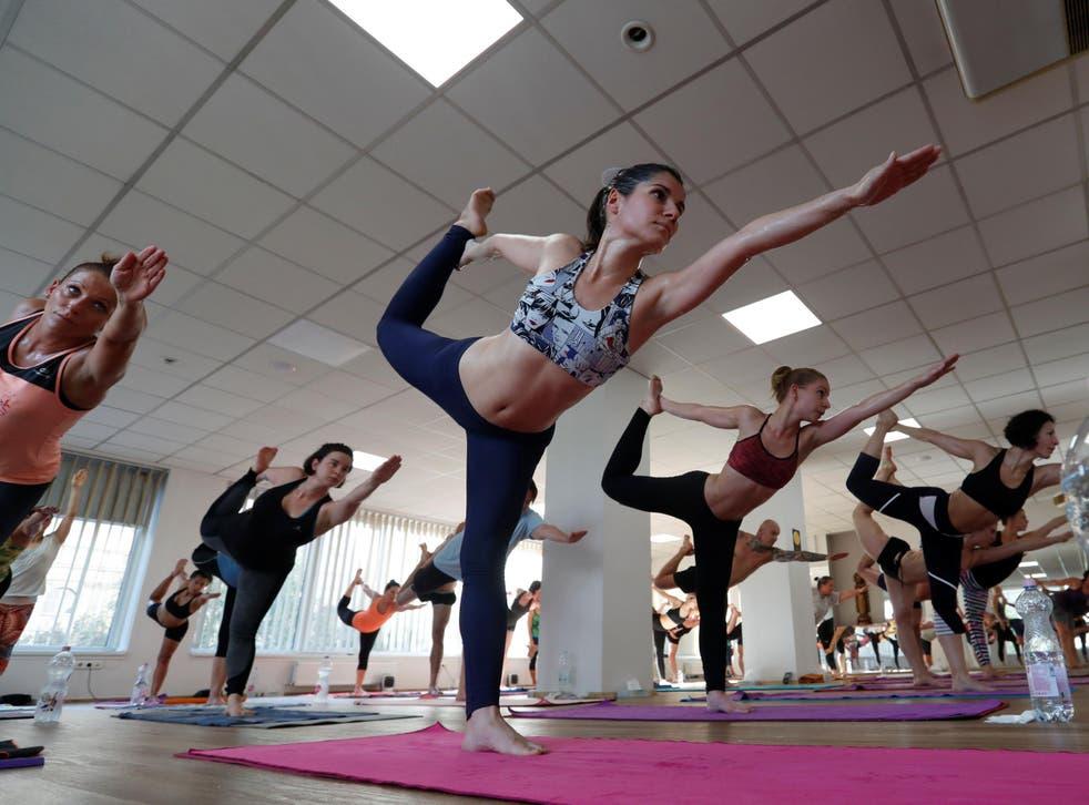 People attend a yoga class at a Bikram yoga centre
