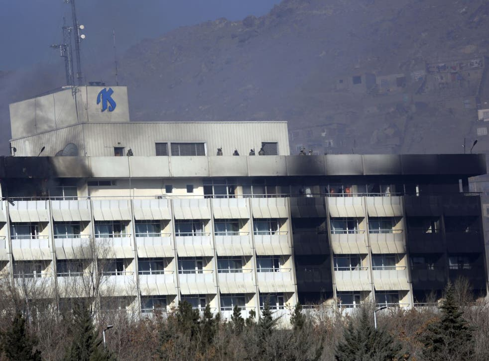 Afghan security personnel are seen at the roof of Intercontinental Hotel after an attack in Kabul, Afghanistan, Sunday, 21 January 2018