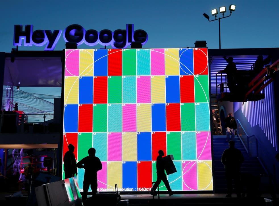 Technicians work on a Hey Google booth in front of the Las Vegas Convention Center in preparation for the 2018 CES in Las Vegas, Nevada, U.S. January 6, 2018