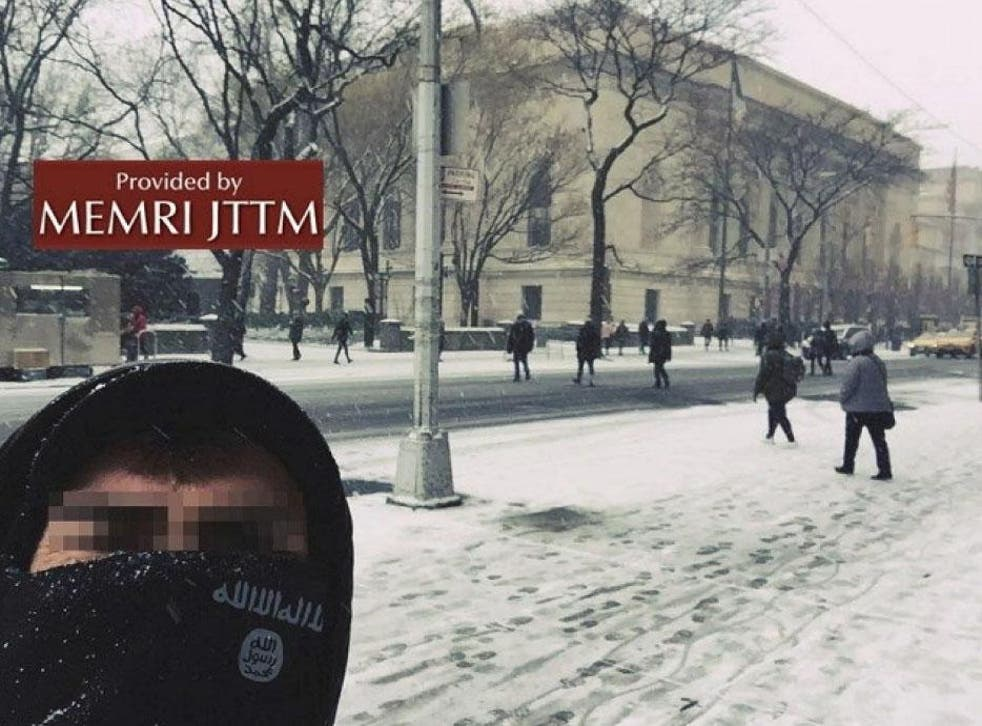 """A supposed Isis supporter poses in front of New York Metropolitan museum, posted on 30 December 2017. The caption that appeared on the social messaging platform Telegram, with the original post said, """"We are in your home"""""""