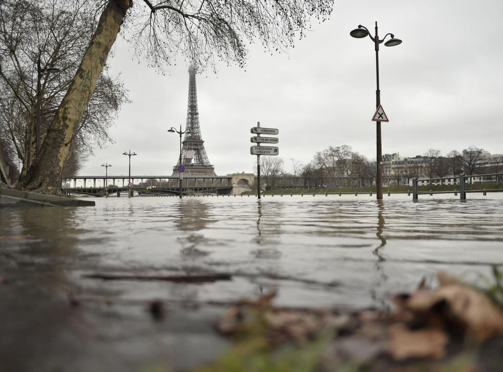 A photo taken on 23 January shows flooded banks of the river Seine, which has overflown after torrential rain has battered Paris