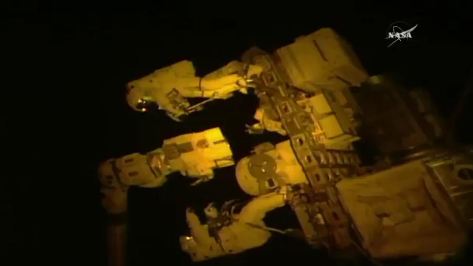 Nasa astronauts work on robotic arm outside International Space Station