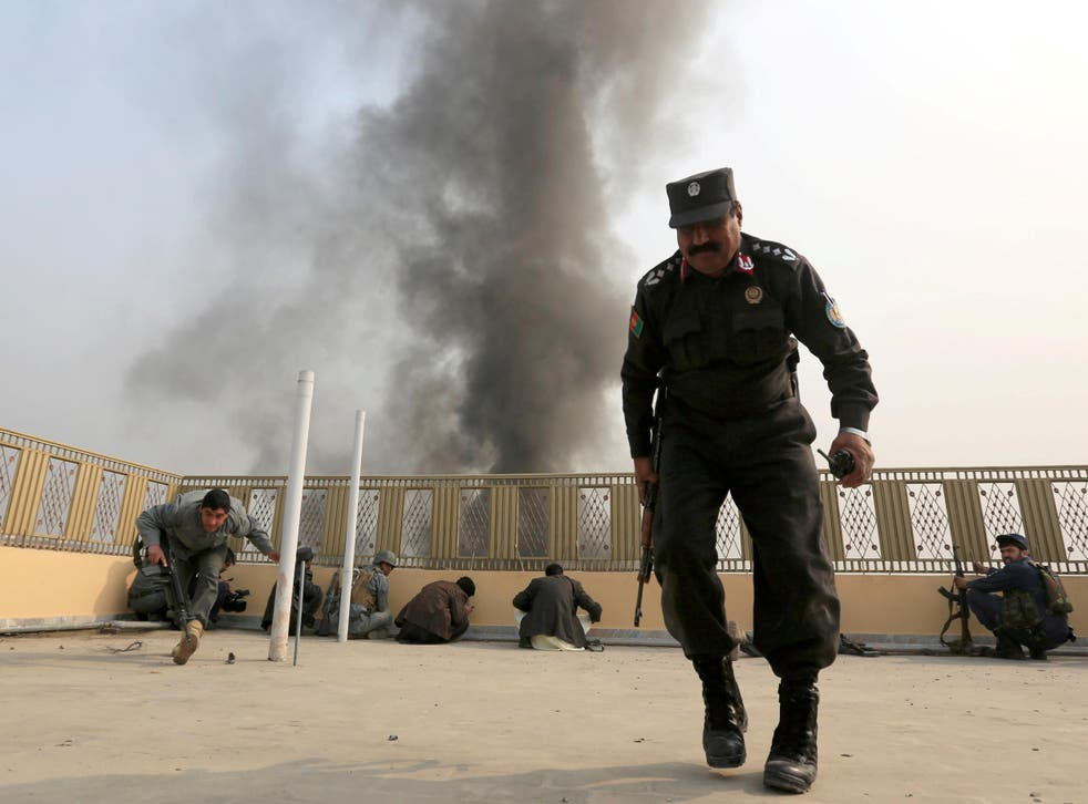 Afghan police officers take position during the fight against Isis militants in Jalalabad