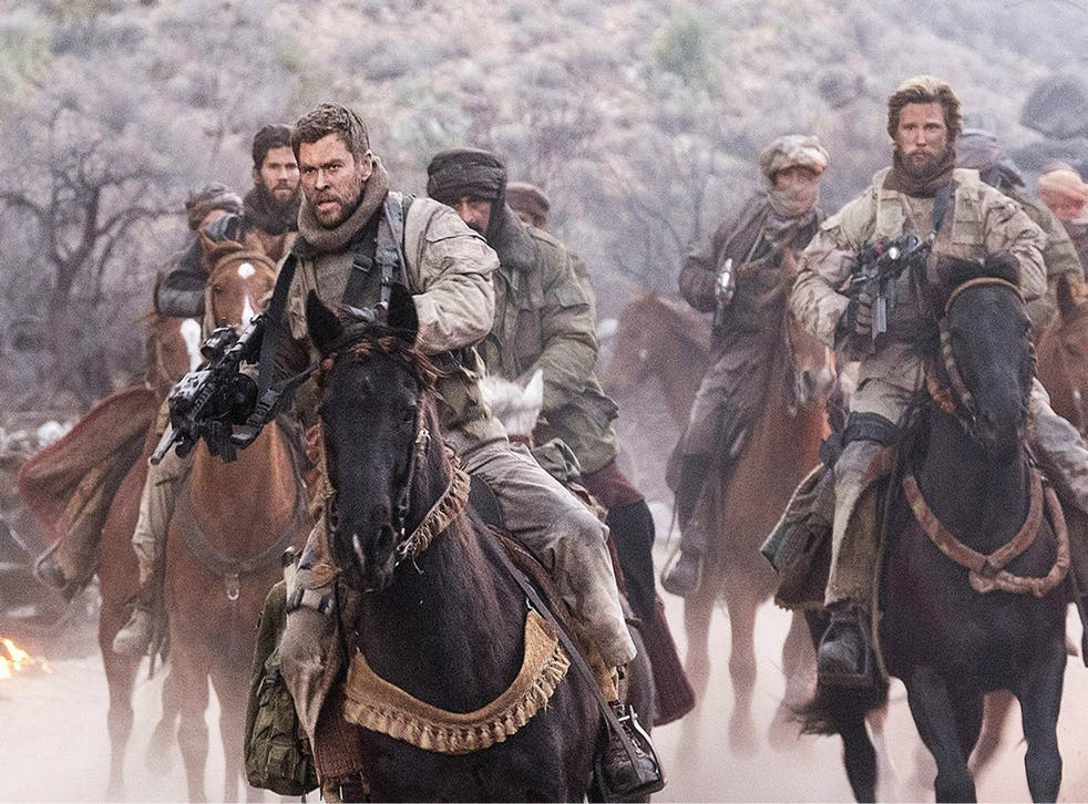 Chris Hemsworth (left) and his men take to the saddle in the Afghanistan-set '12 Strong'