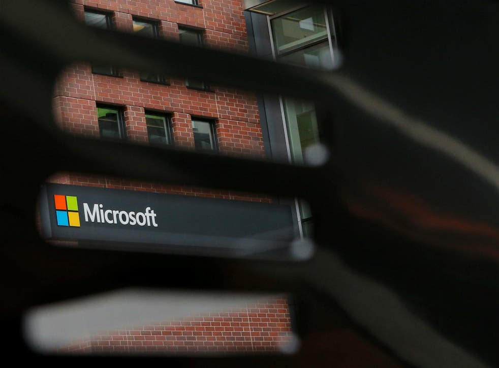 A bench frames a sign outside the Microsoft office in Cambridge, Massachusetts, U.S. May 15, 2017