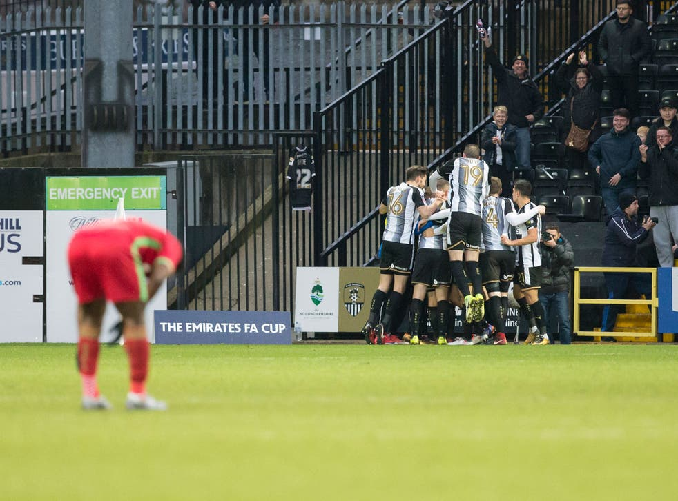 Jon Stead celebrates with his teammates after scoring Notts County's equaliser