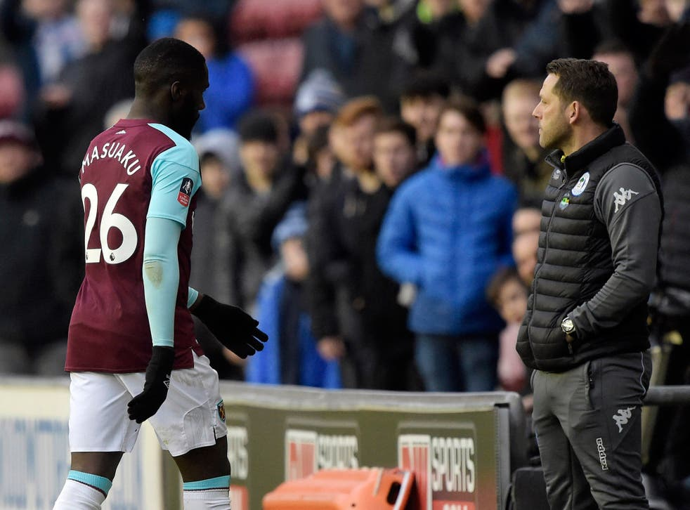 Arthur Masuaku is facing disciplinary action after being sent off for spitting during West Ham's defeat by Wigan