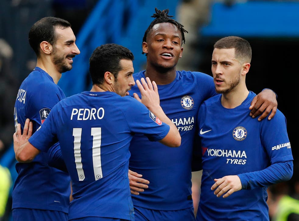 Michy Batshuayi celebrates with his Chelsea teammates after scoring his second goal against Newcastle