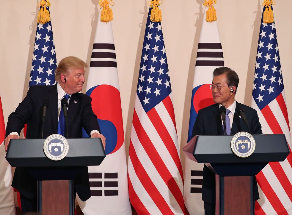 US President Donald Trump talks with South Korean President Moon Jae-in