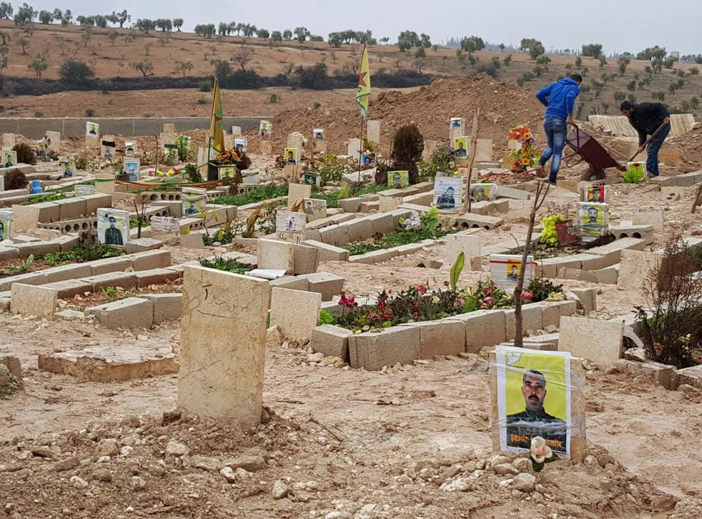 Fresh graves for the Kurds of Afrin. The digging machines are preparing for the bodies of eight Kurdish militiamen and civilians killed by Turkish fire in the Syrian province last week