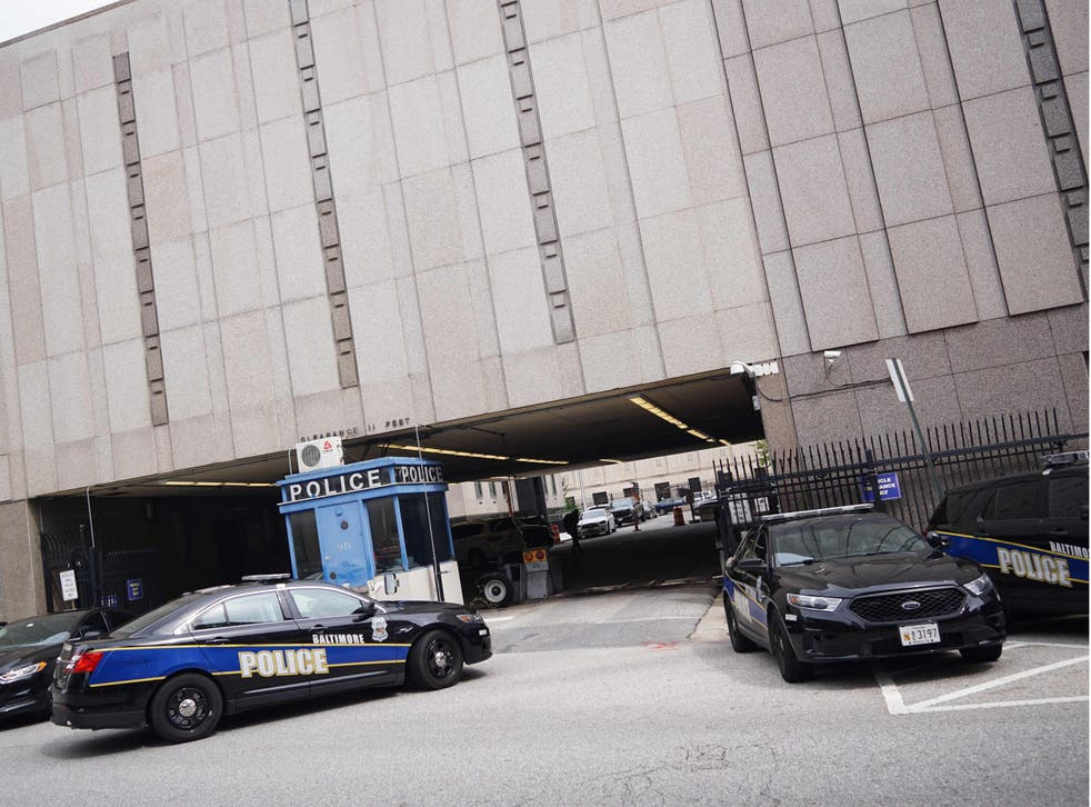 Police cars outside the Baltimore Police Department headquarters