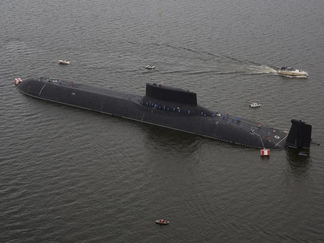 An aerial view shows the Russian nuclear submarine Dmitry Donskoy moored on the eve of the the Navy Day parade in Kronshtadt, a seaport town in the suburb of St. Petersburg, Russia
