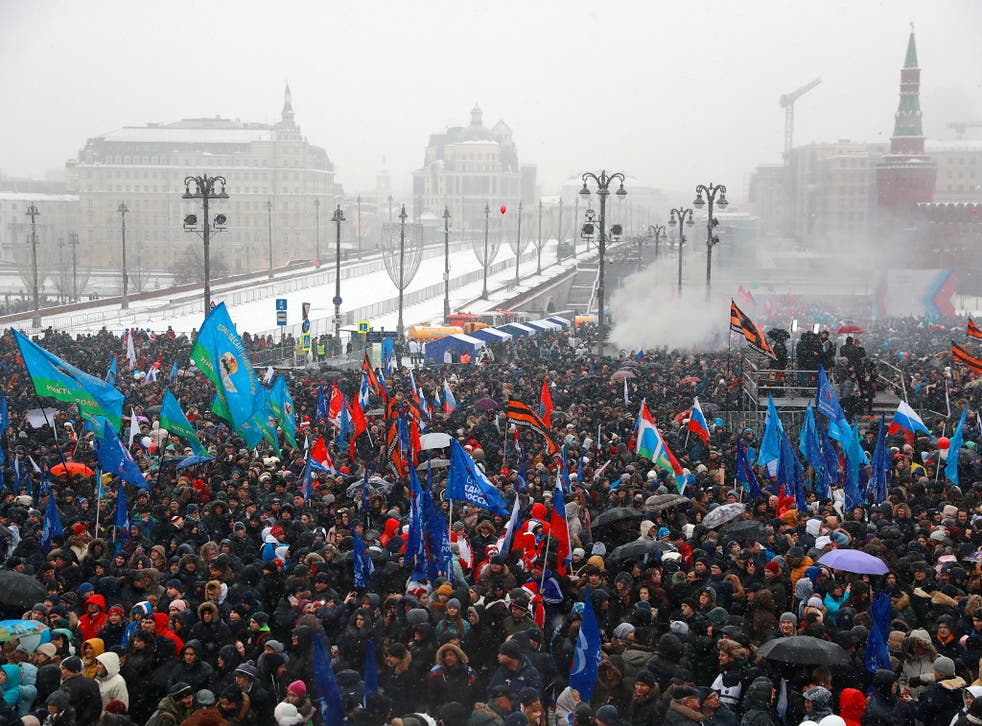 People take part in a rally titled 'Russia is in my heart!' in Vasilyevsky Spusk Square near Moscow's Kremlin