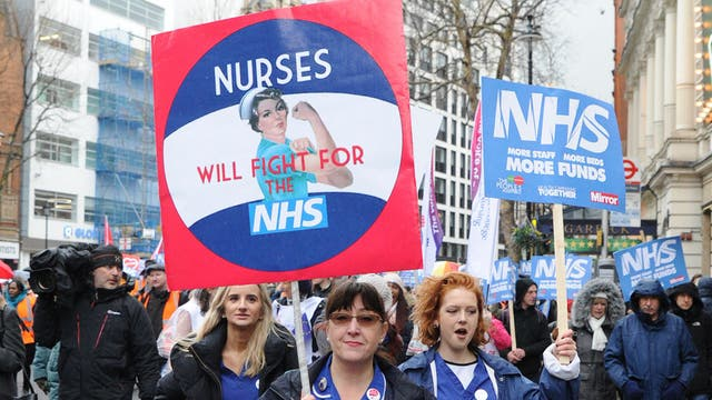 Protesters call on the government to reverse cuts to the NHS.