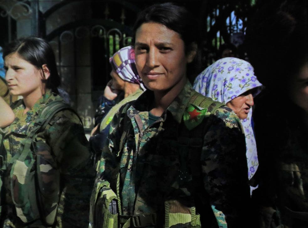 Barin Kobani, centre, was killed in action in Qurna early this week