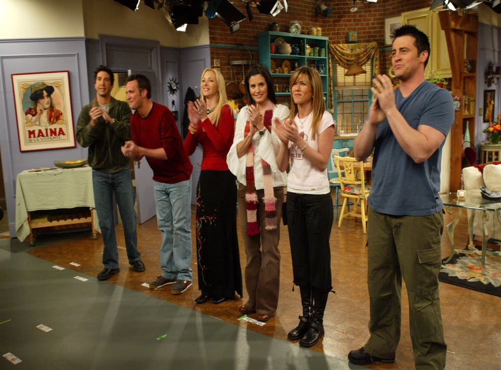 The Friends cast on the set of their sprawling apartment - the real life location is less impressive