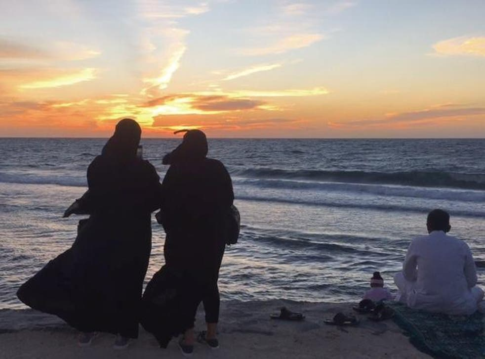 Teenage girls gaze at the sun setting on Jeddah's newly restored Corniche