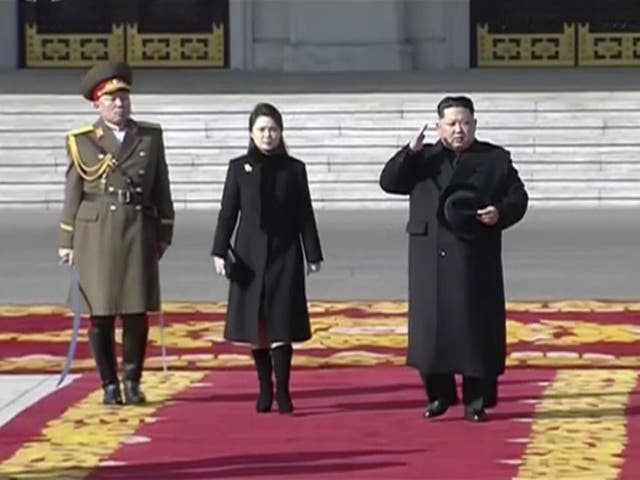Kim Jong-un inspects a military parade on the eve of the Winter Olympics