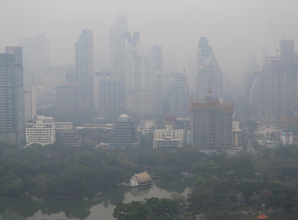 The Bangkok skyline swathed in morning air pollution