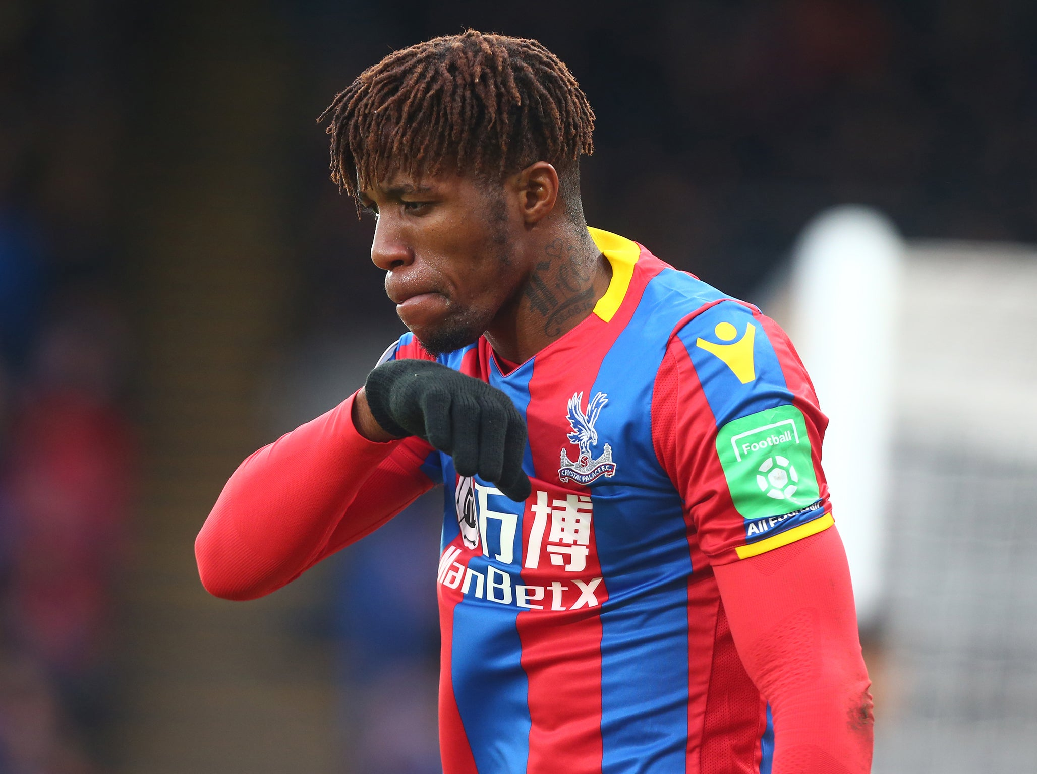 Wilfried Zaha: Crystal Palace forward ruled out for a month with knee injury