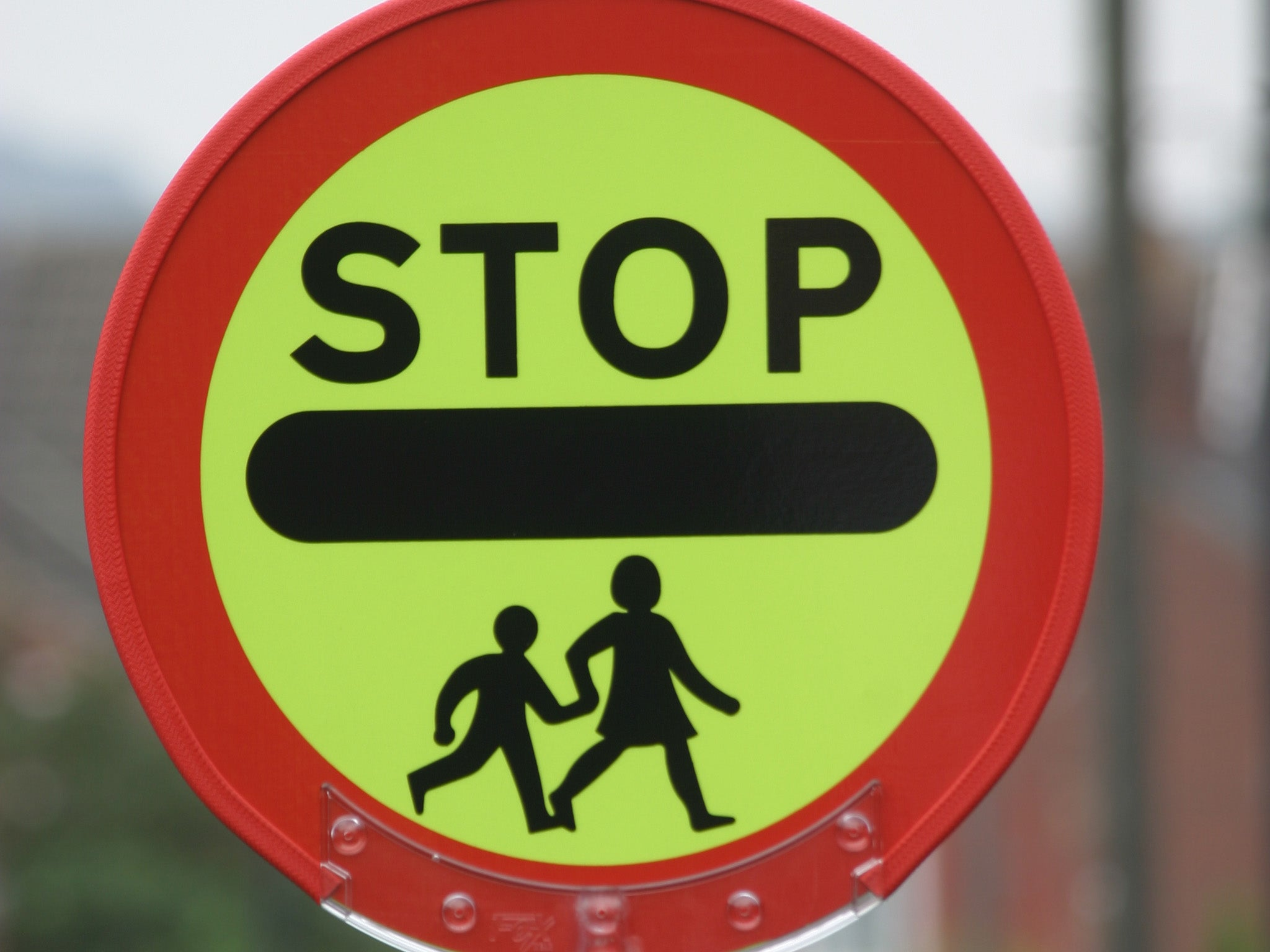 Stockport Council lifts ban on lollipop man giving children high fives