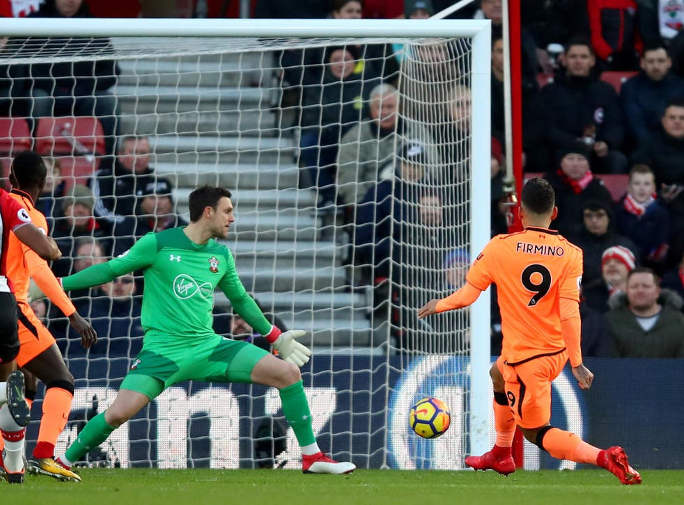 Roberto Firmino slots in Liverpool's opening goal