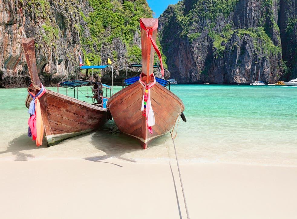 Long tail wooden boats at Maya Bay, Thailand