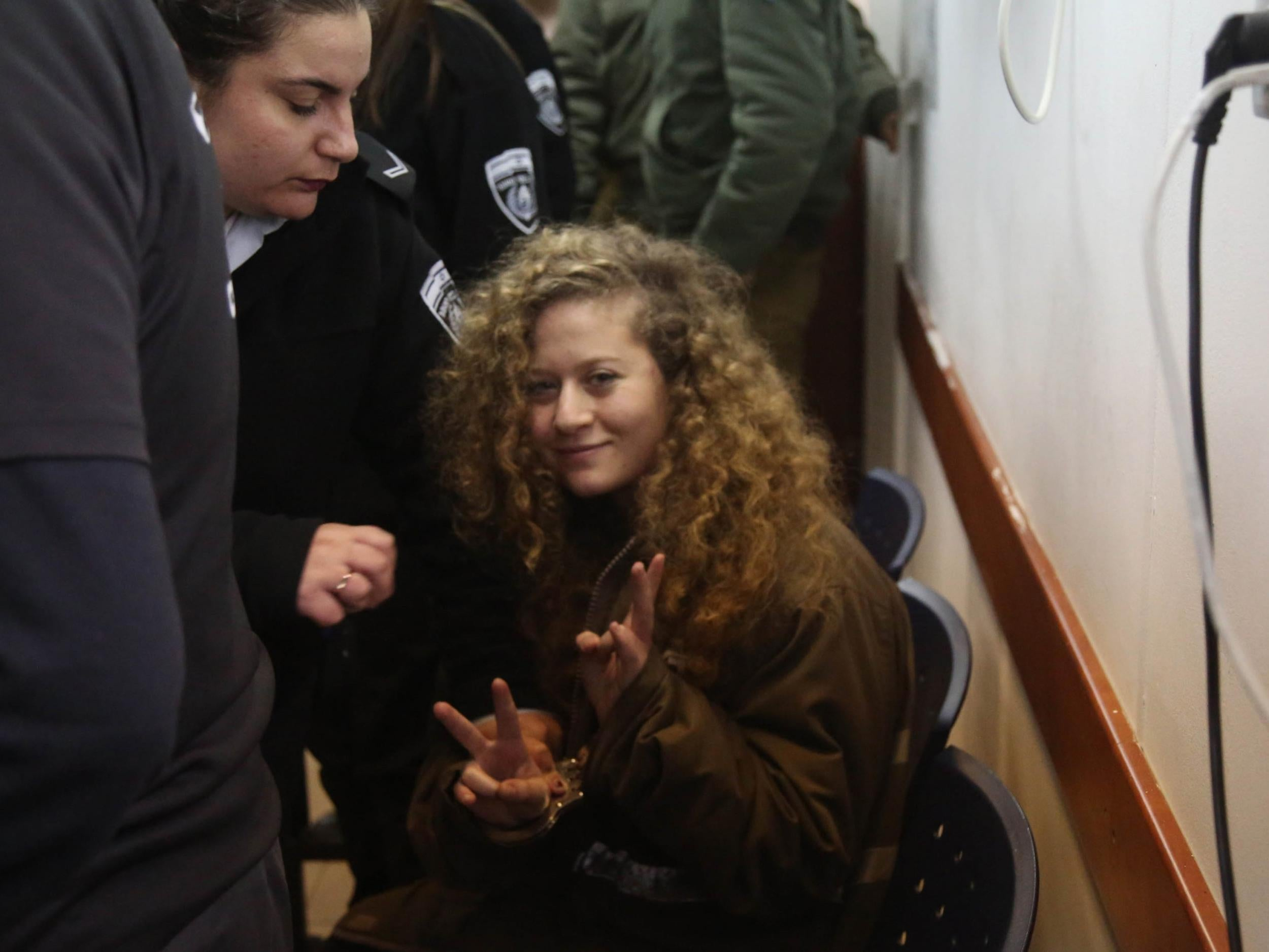Israeli military court orders teenager who slapped soldier to stay in jail for another month