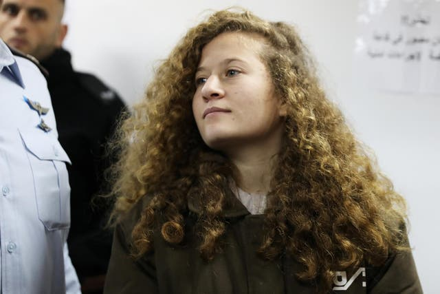 Palestinian teenager Ahed Tamimi enters a military courtroom at Ofer Prison, near the West Bank city of Ramallah, in a previous hearing on 15 January 2018