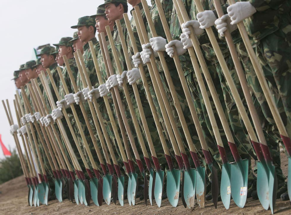 A large regiment of the People's Liberation Army, along with some of the nation's armed police force, have been withdrawn from their posts to work non-military tasks, such as planting trees