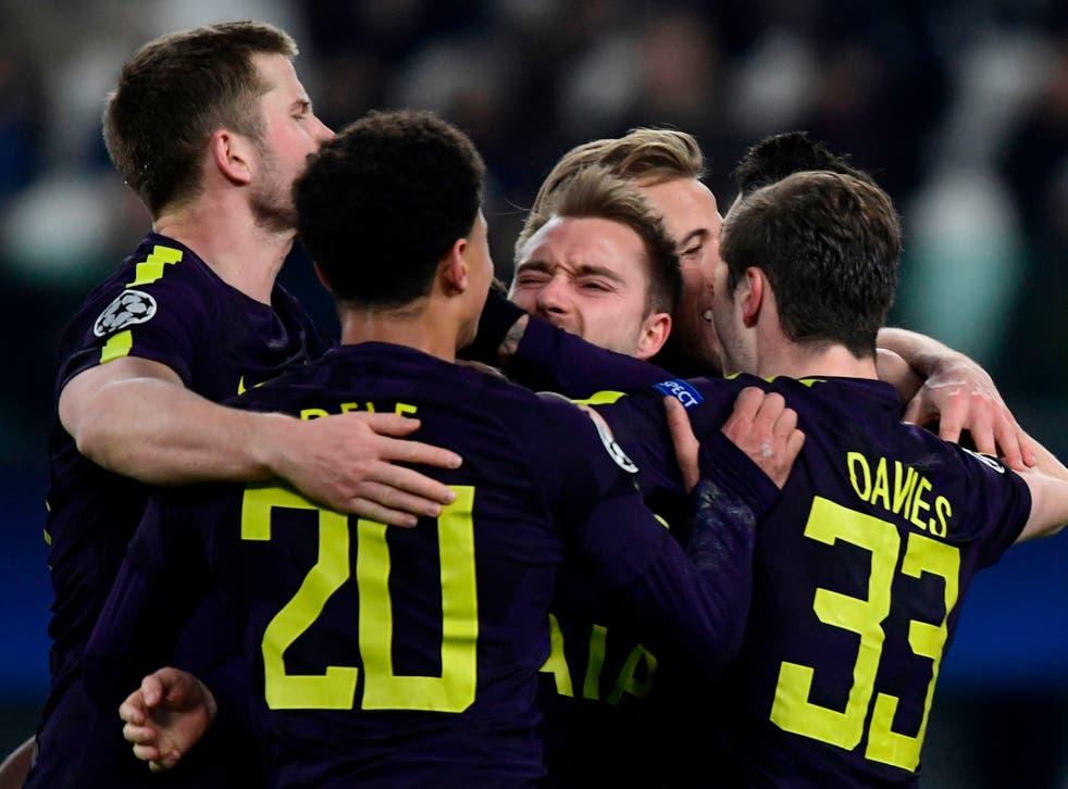 Christian Eriksen is mobbed after scoring Tottenham's second