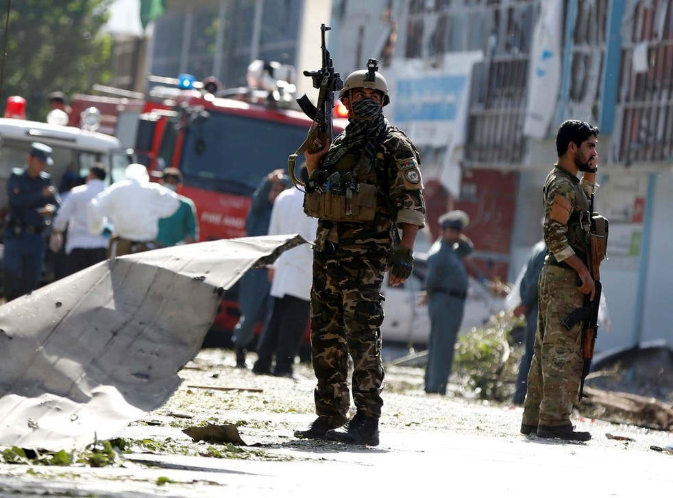 Afghan security forces at the site of a suicide attack in Kabul