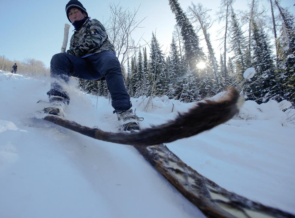 Horse-hide skis, like the ones being used here by Alimase, are traditional in the region