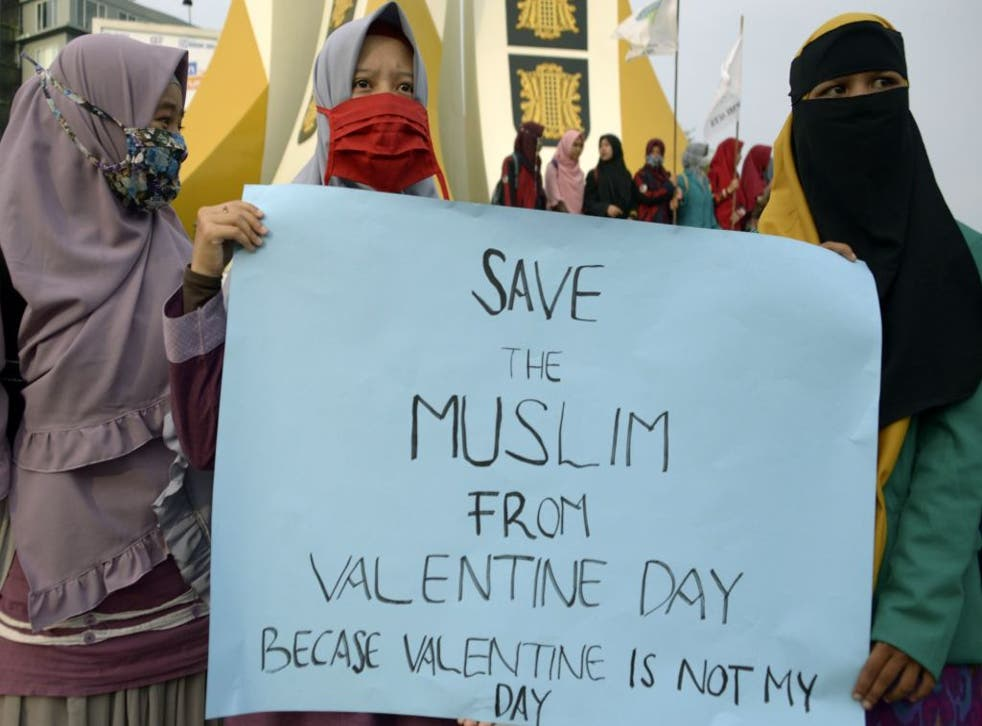 Indonesian Muslim students hold a protest against Valentine's Day in Banda Aceh on February 14, 2018
