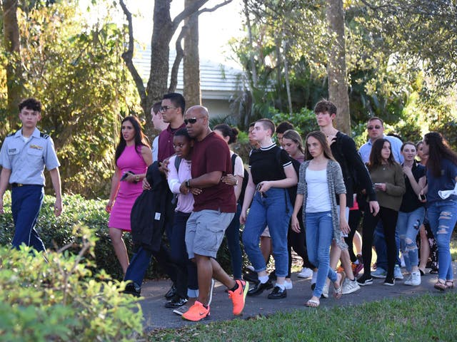 Students are led away after a  gunman opened fire at Marjory Stoneman Douglas High School in Parkland, Florida